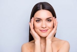 a woman with smooth and glowing skin after facial rejuvenation