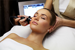 a woman receiving laser treatment on her face